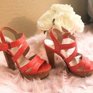 Cork high heeled sandals.